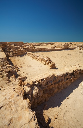 dilapidated wall: Ruins of the original trading post just a few hundred meters from Fort Al Zubarah in the northern Qatar desert, Middle East
