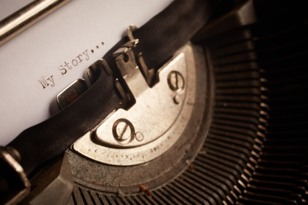 A Closeup image of the typebars and ribbon of an old style typewriter and paper with the text  My Story     Shallow Depth of Field  photo