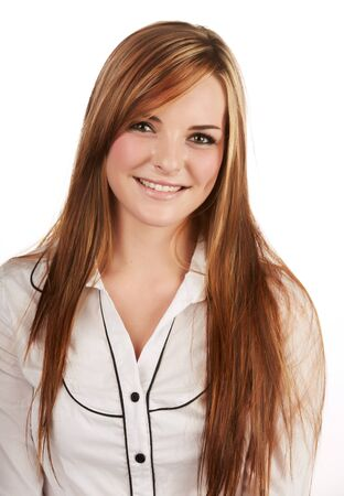 plain button: Beautiful young caucasian adult woman with long auburn red hair on a plain background, wearing a white button shirt  Stock Photo