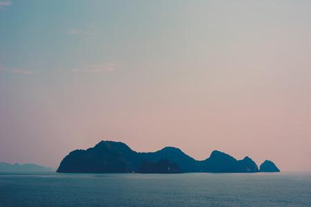 halong: Halong Bay Island Sunset Stock Photo