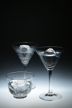 extreme macro: Three Glasses With Cold Water Closeup On White Background