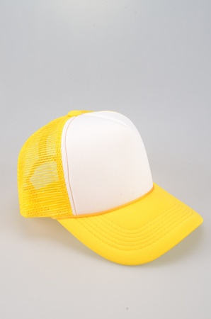 adulation: Yellow Cap Isolated On White Background Stock Photo