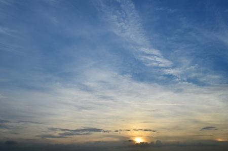 Sun Behind Clouds At Sunrise  photo