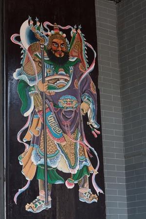 Chinese God pattern art in Buddha temple gate photo