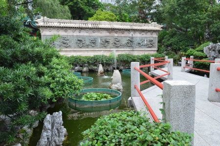 Chinese Water Garden Bridge and Reflection Amid Modern High  Stock Photo - 21183918