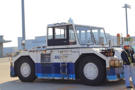 tow tractor: White pushback tractor