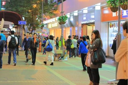 overcrowded: Mongkok District at night in Hong Kong, China  Mongkok in Kowloon Peninsula is the most busy and overcrowded district in Hong Kong