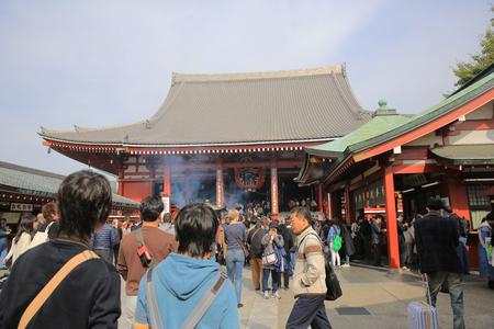 sightseers: Tourists and sightseers wander around Sensoji Temple  Editorial