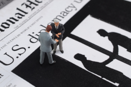 a small figures and newspaper Stock Photo - 25675530