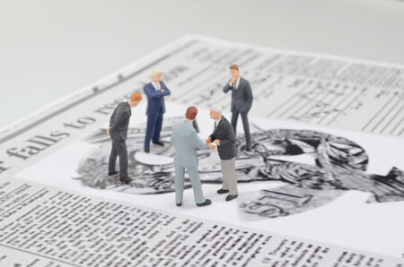 a small figures and newspaper Stock Photo - 25675642