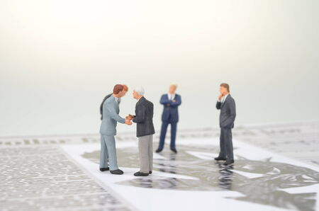 a small figures and newspaper Stock Photo - 25675644