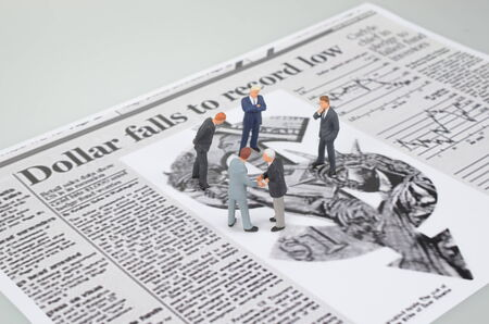 a small figures and newspaper Stock Photo - 25675652