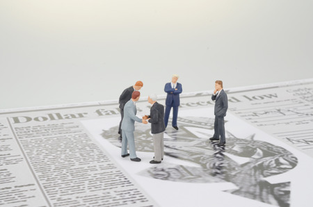 a small figures and newspaper Stock Photo - 25675654