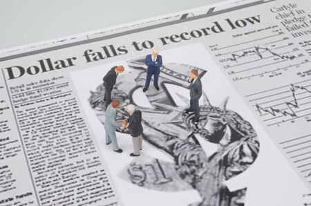 a small figures and newspaper Stock Photo - 25701559