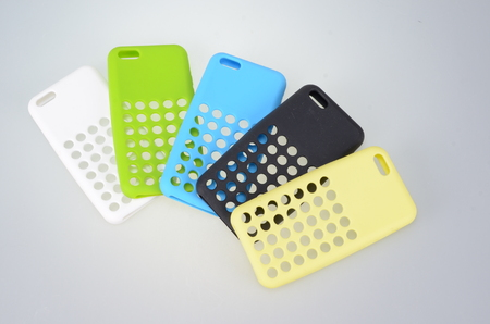 MultiColor Mobile Phone plastic cases on a white background photo