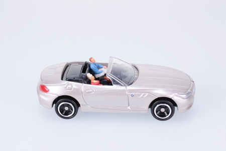 small figure sit in the toy car photo