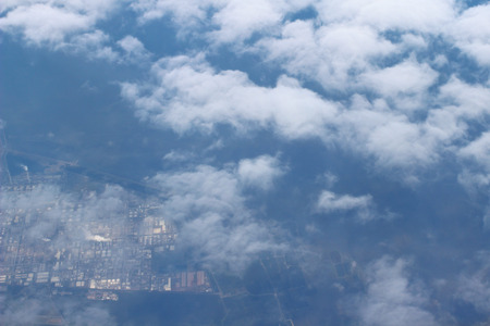 clouds  view from the window of an airplane flying in the clouds photo