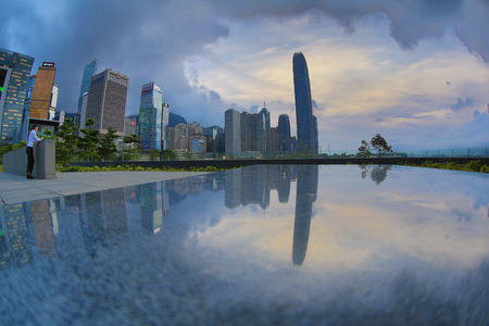 Skyline of Hong Kong at sunset with reflection