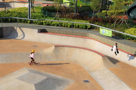 Teenagers skate in Tseung Kwan O Skatepark