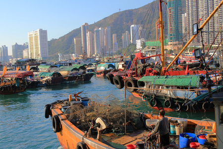 Traditional junks in the Aberdeen Bay. Famous floating village in Aberdeen is an area and town on the south shore of Hong Kong Island