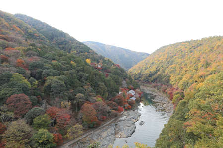 Unidentified people sail boates in the Oi river for tourist who travel to Arashiyama mountain area