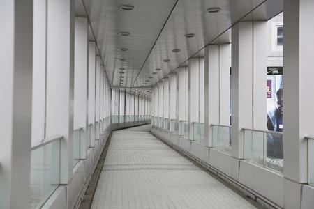 elevated walkway: Long walkway in modern building