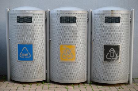 bins: three recycling bins