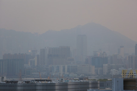 Hong Kong obscured by air pollution, as seen from kowloon bay