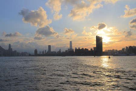 the Victoria Harbor of Hong Kong at sunset photo