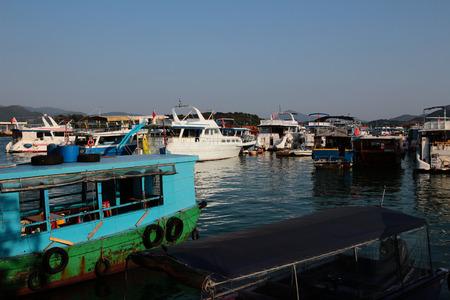 boatman: Junks park at the harbor in Sai Kung.