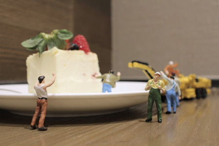 artisans: the Group of of tiny miniature artisans working together