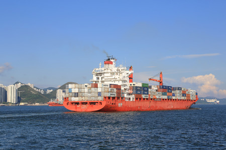 containership: Cargo ship passing the East Lamma Channel hk Editorial