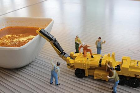 bolognaise: the  Miniature figure working on Bolognaise Stock Photo