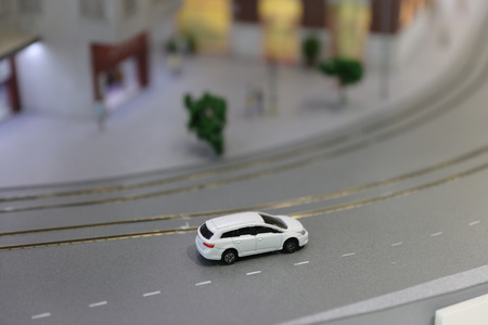 the Toy car and the model house