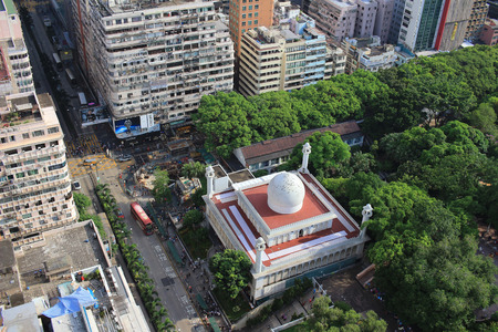 Chinese-style building and mosque tower in Kowloon, Hong Kong