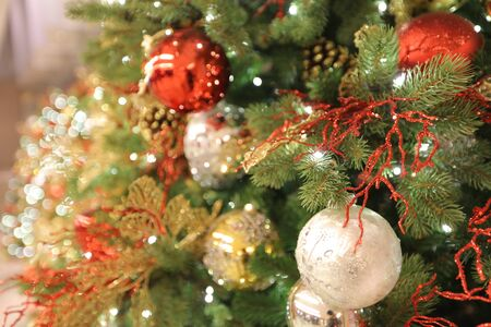 artifical: the Closeup of Christmas ornaments on artifical tree