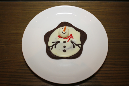 figurative: the gingerbread snowman biscuits with white plate