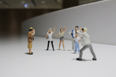 miniature people: the Miniature people family concept with white background