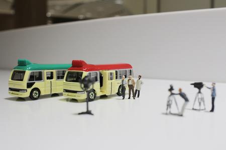 minibus: the movie making of small figure of minibus stop Stock Photo