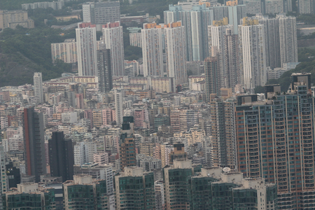 overcrowded: the kowloon cityscape with landmark building