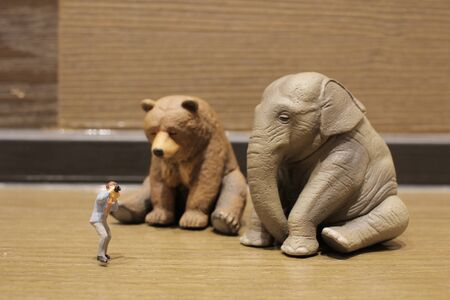 a plastic animal toy with figure people Stock Photo