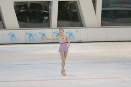 gym dress: Little girl figure skating at sports arena