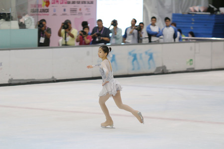 figure skating: Little girl figure skating at sports arena