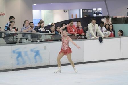 gym dress: Little girl figure skating at sports arena