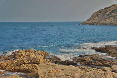 seaboard: the rocky sea coast and blurred water in shek o,hong kong Stock Photo