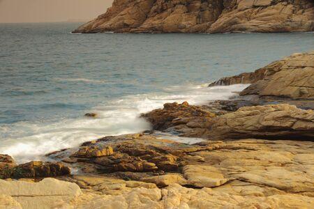 shek: the rocky sea coast and blurred water in shek o,hong kong Stock Photo