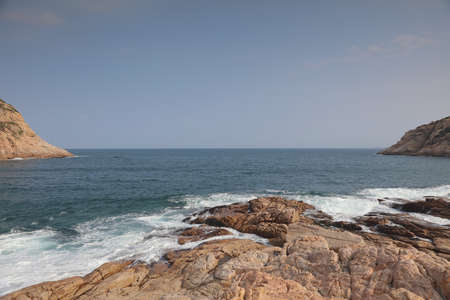 shek: the rocky sea coast and blurred water in shek o,hong kong Stock Photo