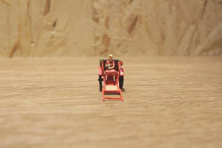 rikscha: the Miniature statue  and red vintage oriental rickshaw cab