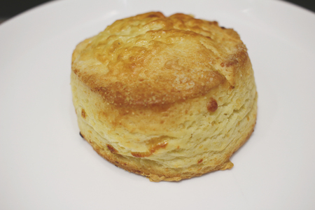 scone: a Scone on white of ceramic plate