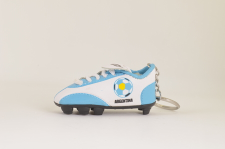 white back ground: sport shose with toy size at the white back ground